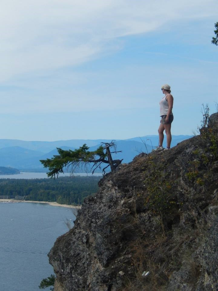 Kim standing on a cliff face