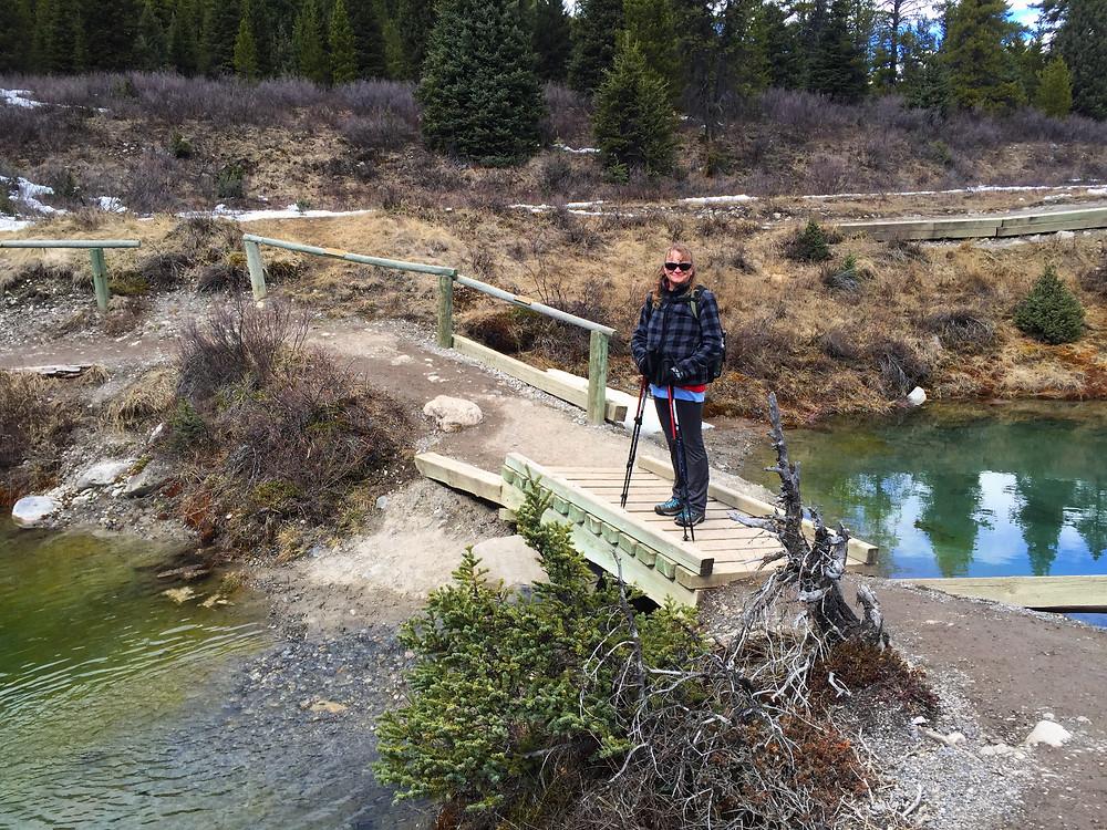Mom posing on a bridge beside the Inkpots
