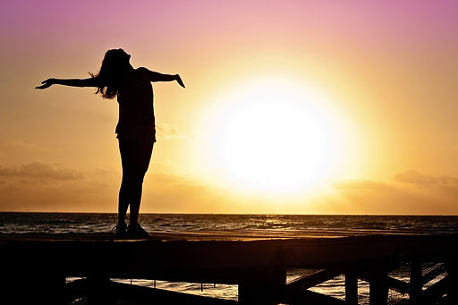 dawn-sunset-beach-woman-39853.jpg