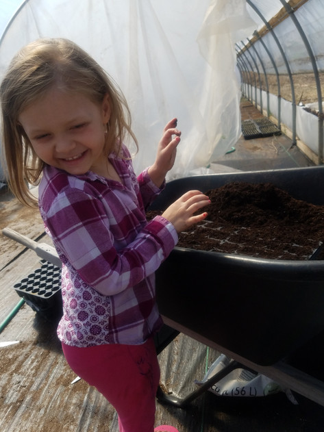 Playing in the greenhouse with mom & dad
