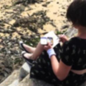 Suki sketching at the beach in Rock, Cornwall, UK.