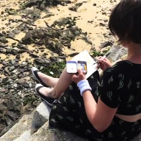 Suki sketching at the beach in Rock, Cornwall, UK.