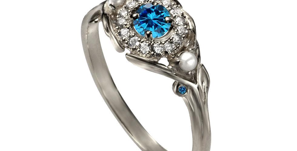 טבעת אירוסין 'עין הפנינה' זהב לבן 14 קראט יהלומים ובלו טופז