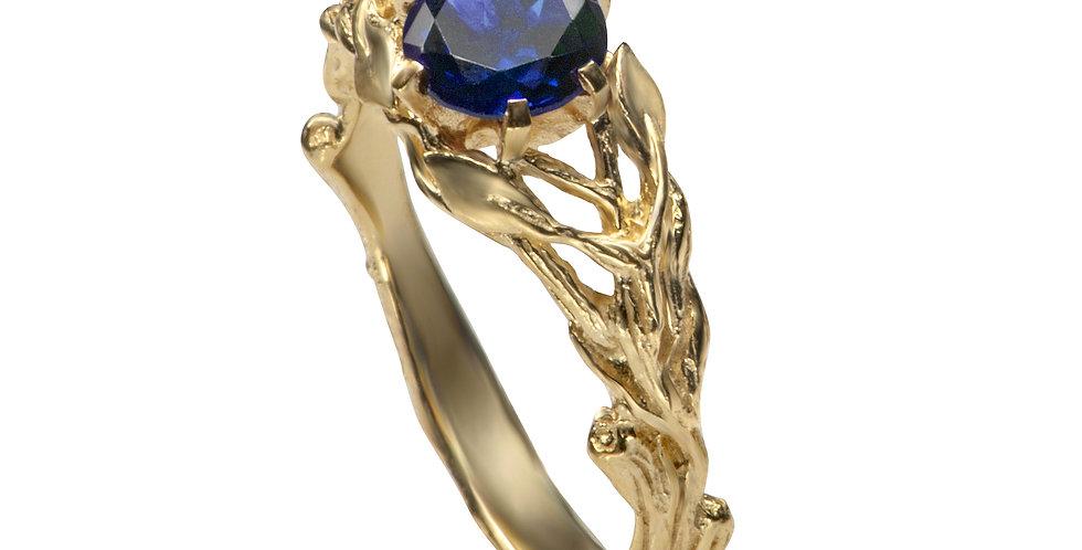 טבעת 'יערות ניו-זילנד' ספיר כחול זהב 14 קראט