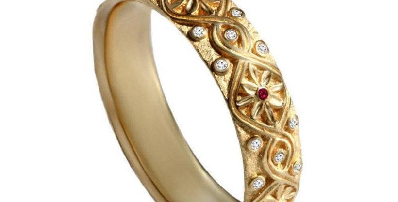 טבעת 'קשר אינסוף' זהב צהוב יהלומים ורובי