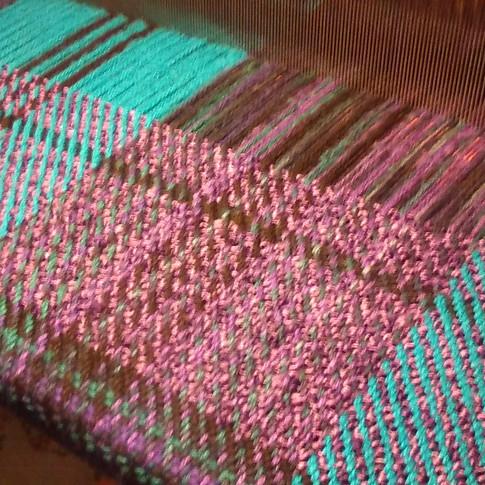 Jewel tones blanket on loom