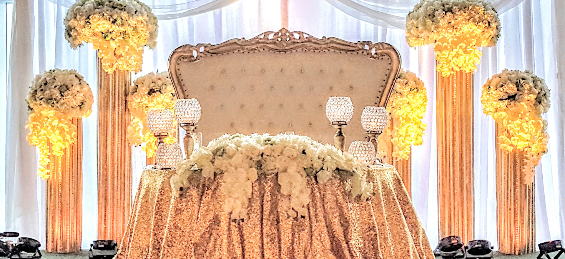 plain draping with 6 gold pillars