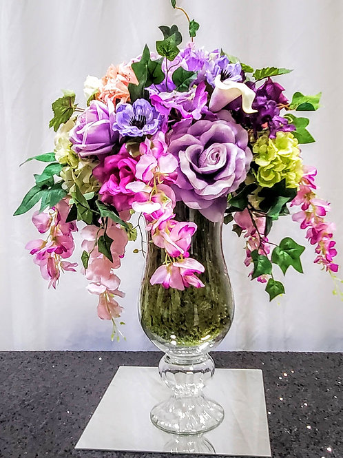 Purple silk arrangement with glass vase