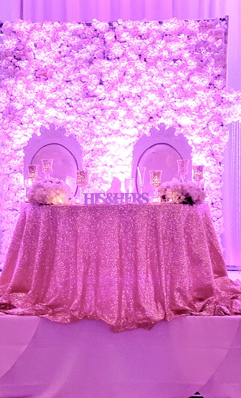 Flower wall conected to flower arch with pipe and drape