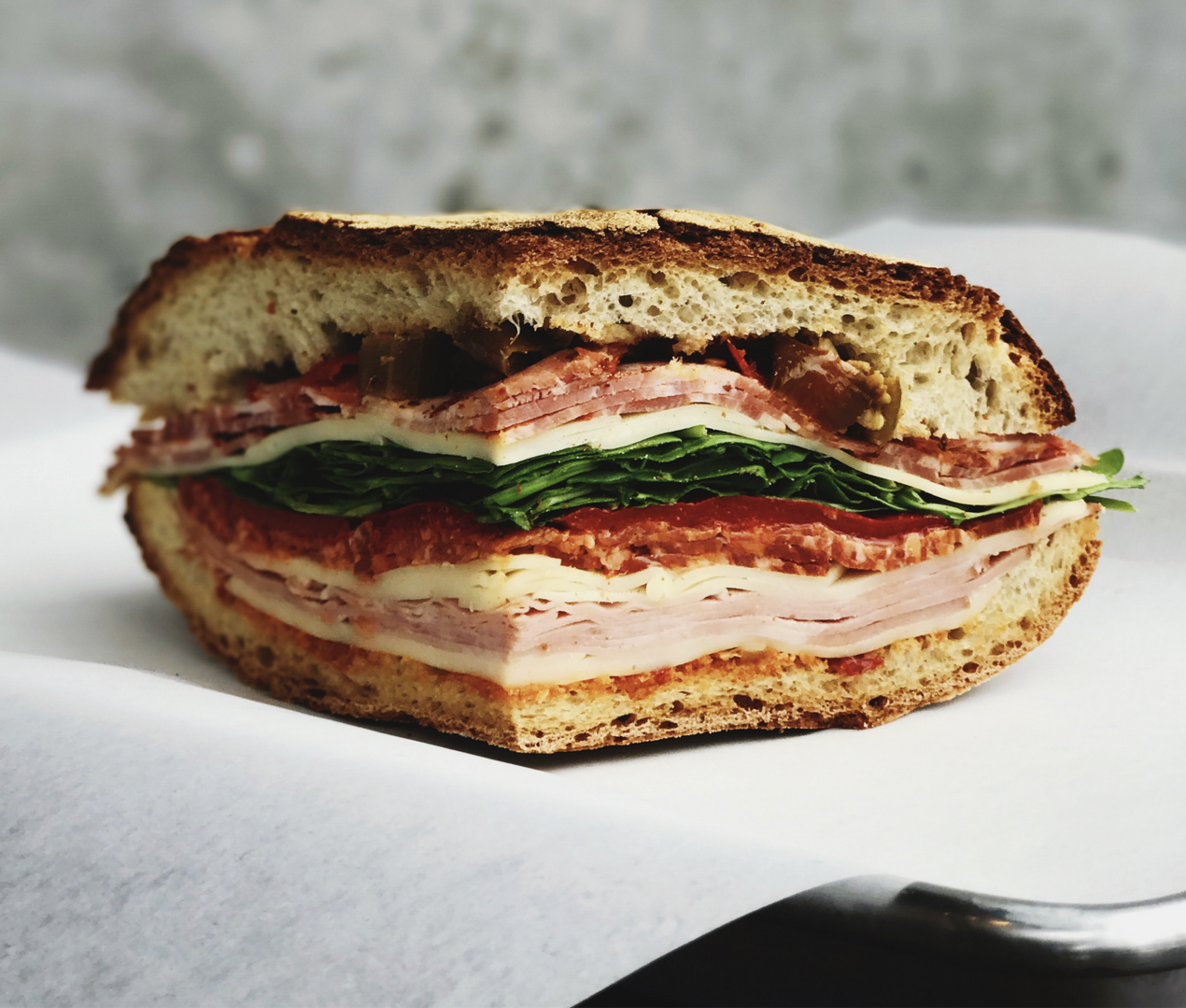 A sandwich on fresh-bakes ciabatta from Saggio's Scratch Italian Kitchen