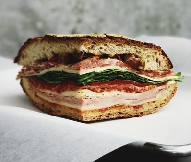 A sandwich on fresh-bakes ciabatta from Saggio's Scratch Italian Kitchen