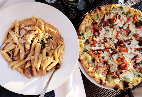 Penne pasta and pizza from Saggios Scratch Italian Kitchen.