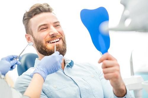 Man Checks Teeth