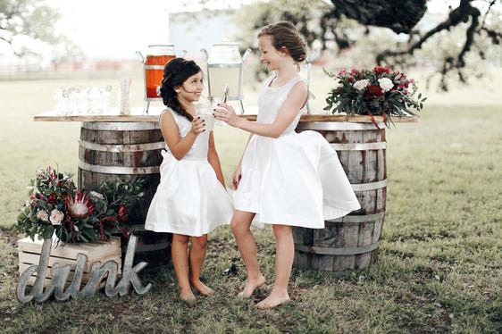 """Flower girls saying """"Cheers!"""""""