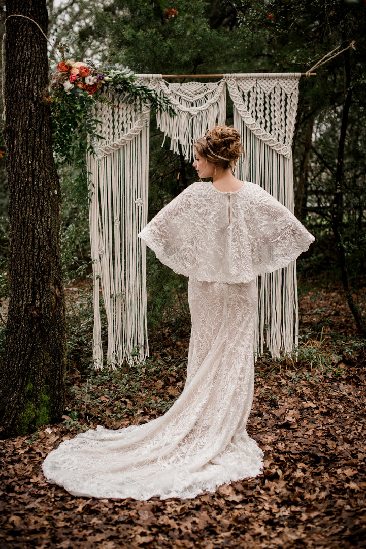 Caped gown adds show-stopping drama