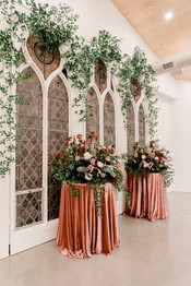 Stained glass draped in greenery