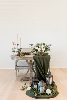 Draped linens and sweetheart bench
