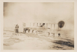 0111 Many men near hydroplane on beach waves with couple