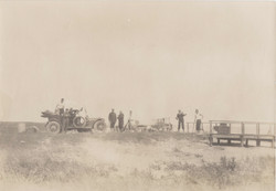 0087 Men with car near bridges
