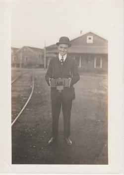 0089 Man with box near railroad tracks