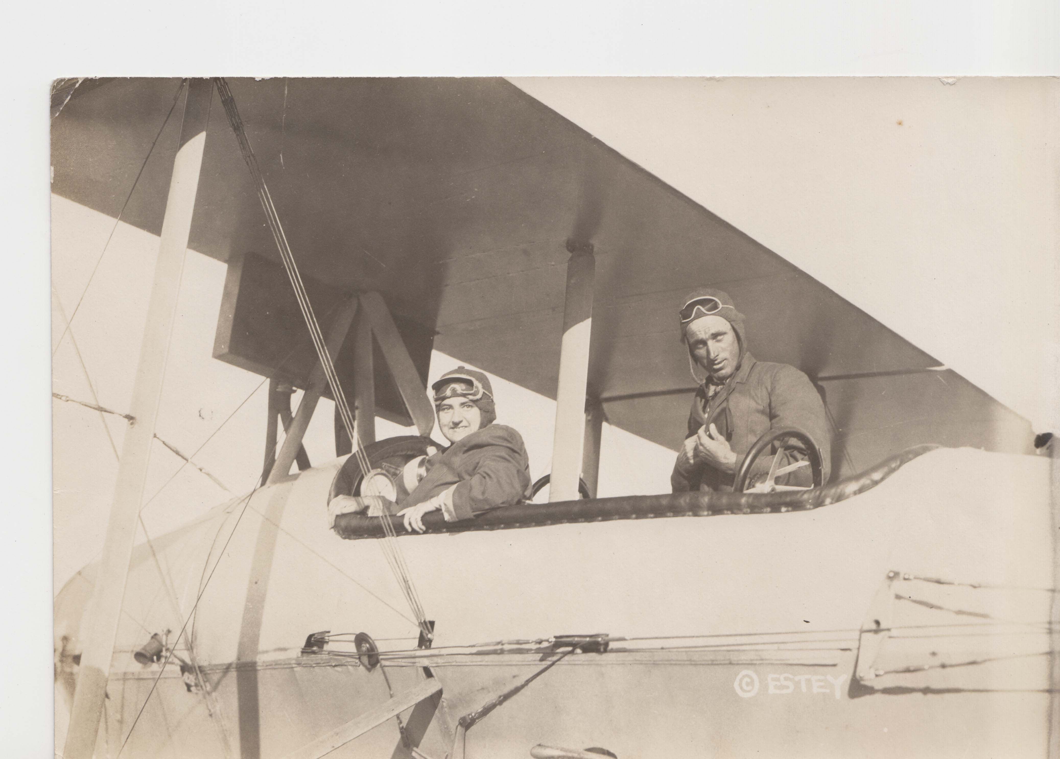 0126 Two pilots in cockpit, facing to the camera