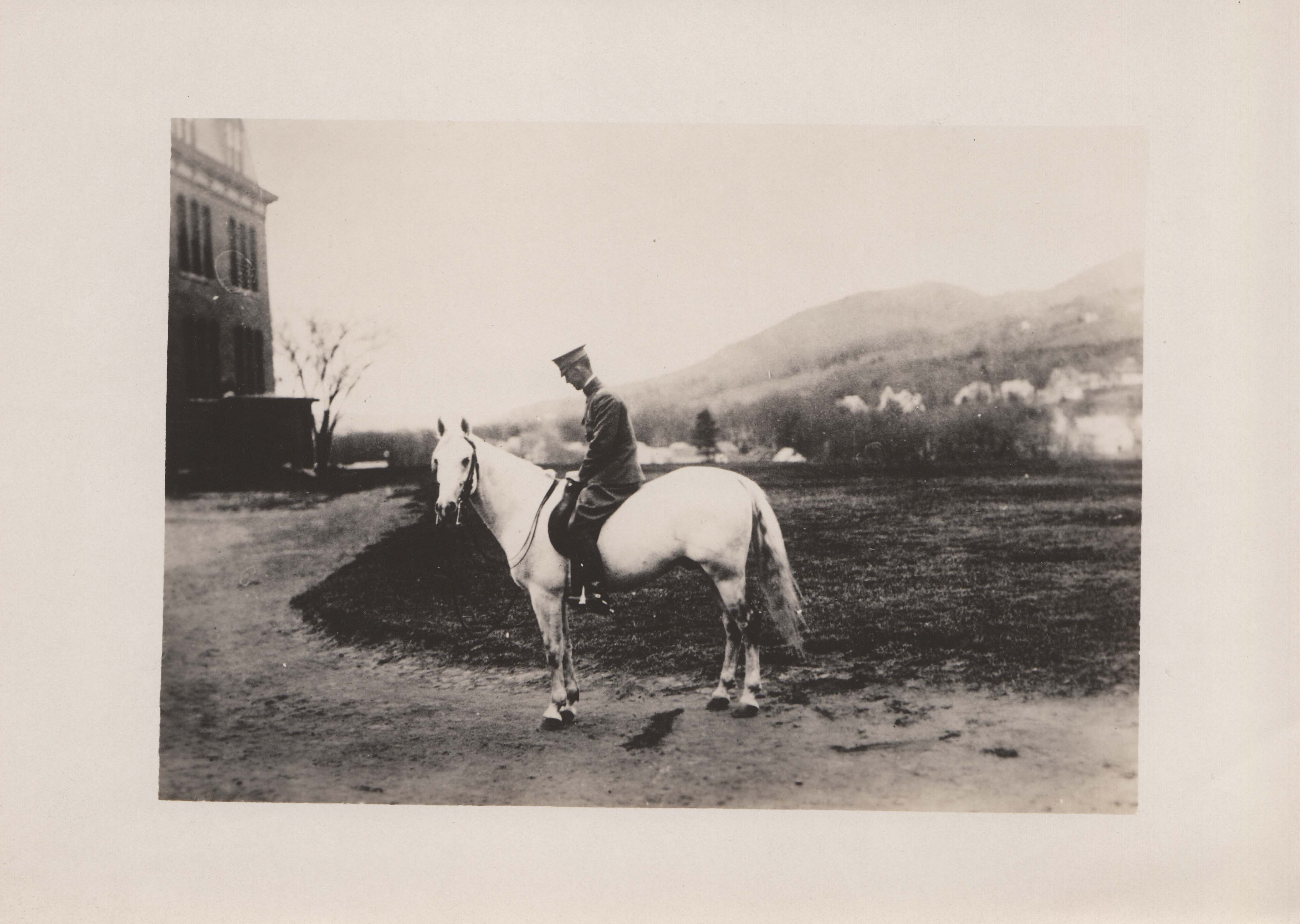 0197 Man on White Horse