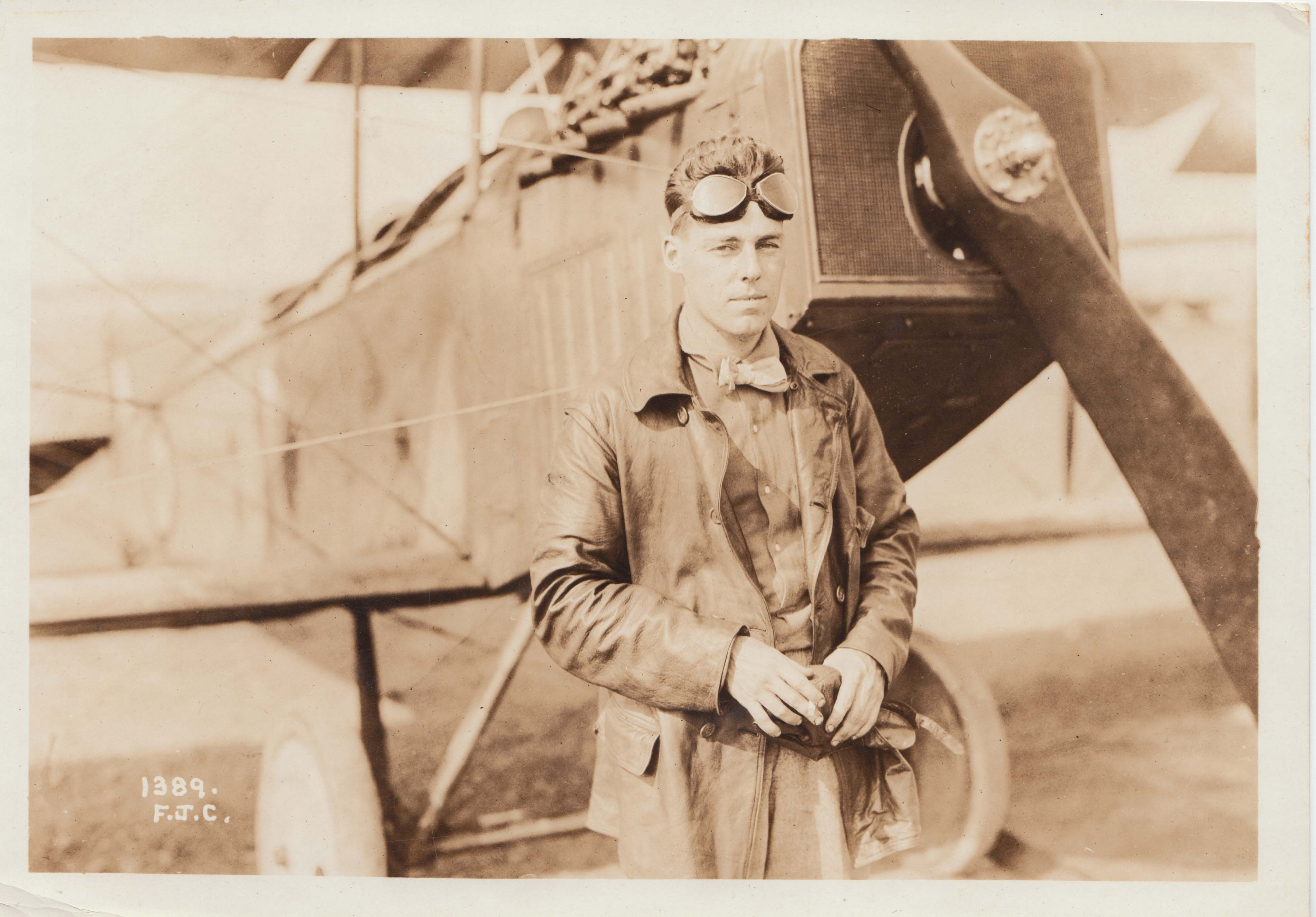 0263 Pilot in front of plane with goggles
