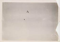0221 A plane  & a parashoot in sky