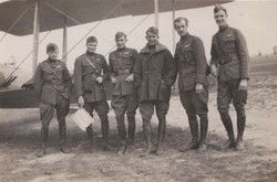 0450 Six Men in Uniform in front of plane