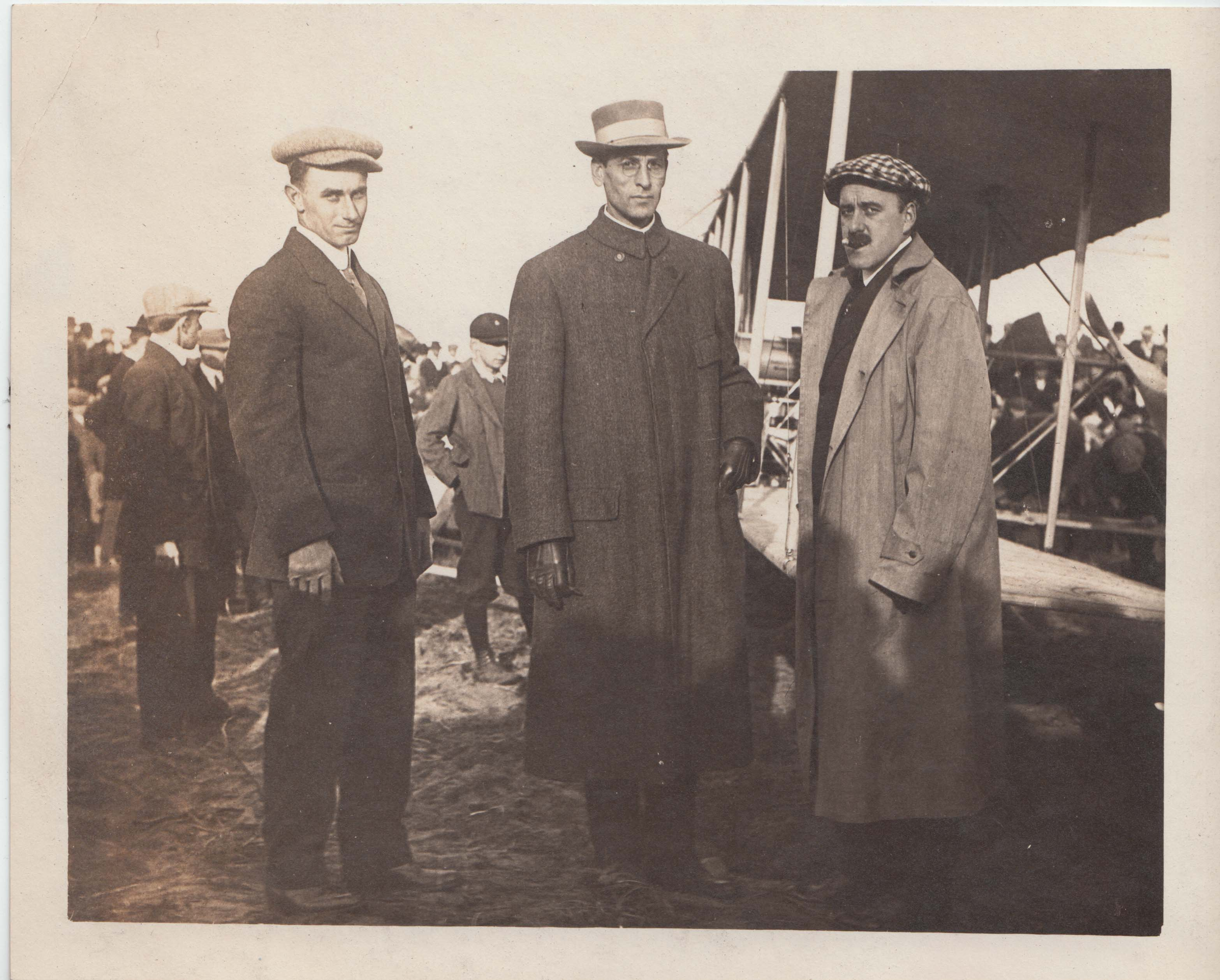 0402A Three Men near Airplane Atwood Estey Letter