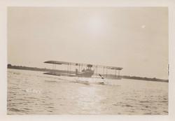 0054 Airplane on Beach Under Sun