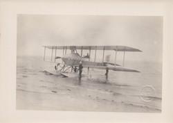 0064 Aeroplane with pilot on beach