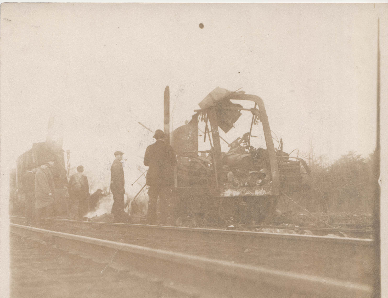 0210A  People investigating burnt car at railroad