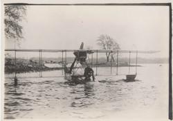 Jack McGee on edge of hydroplane at lake