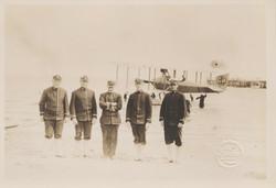 0099 Five Men on Beach near Plane