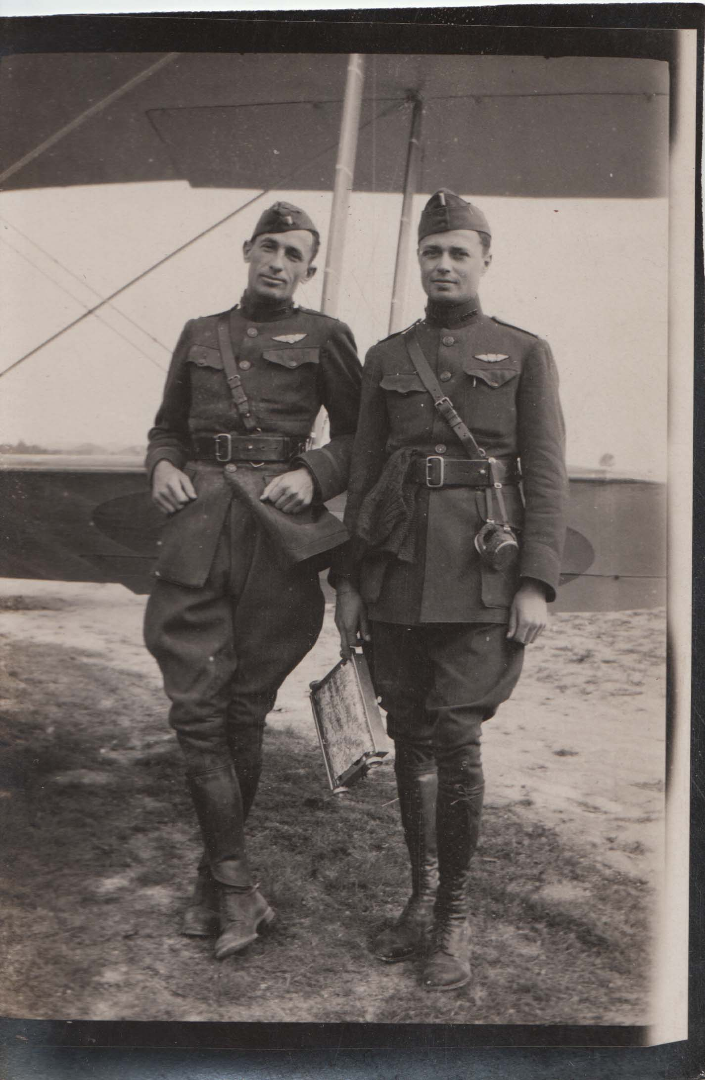 0283 Two Pilots Leaning on Plane
