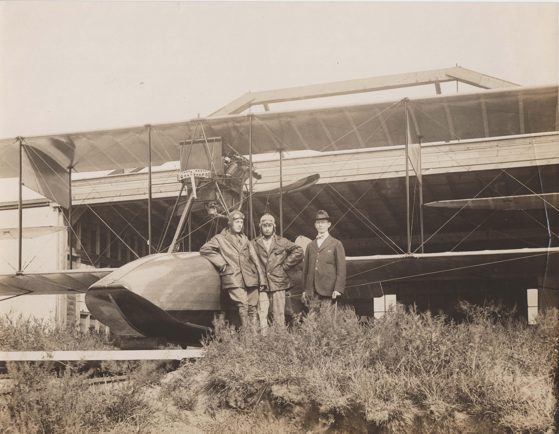 0226 Two pilots & a man beside plane