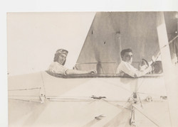 0122 Two pilots in cockpit, facing to the camera