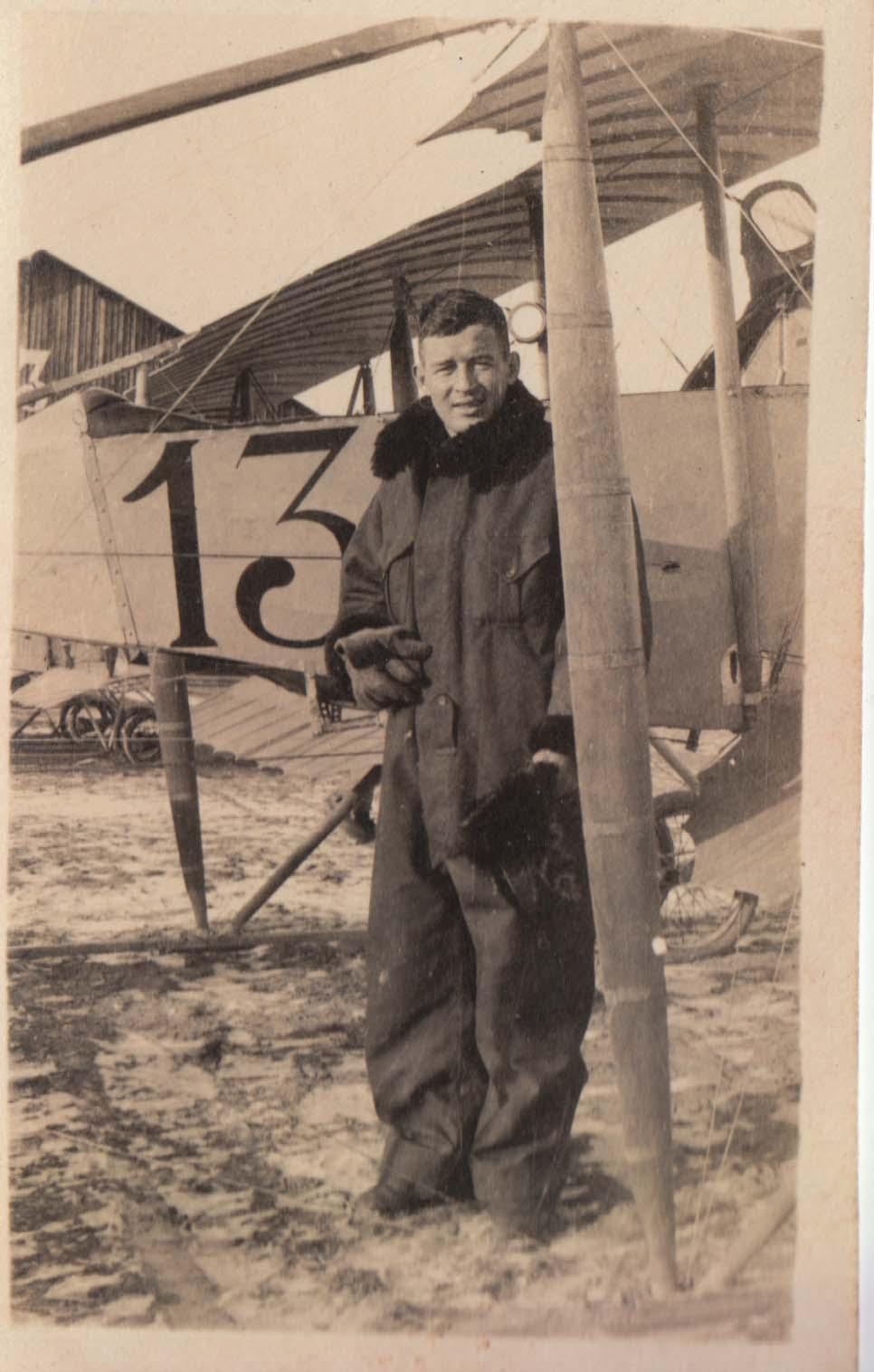 0462 Man in Coat by Plane