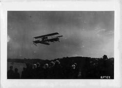 Bi-plane over crowd