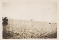 0063 Aeroplane above water near pier
