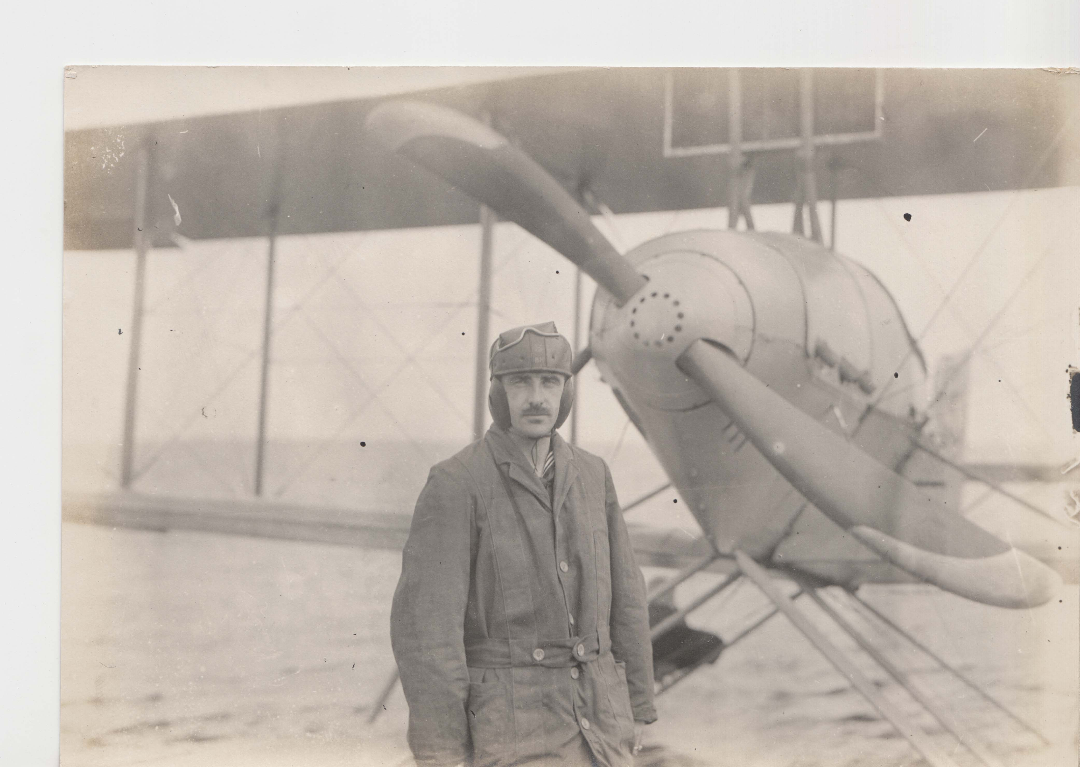Estey in front of aeroplane on beach