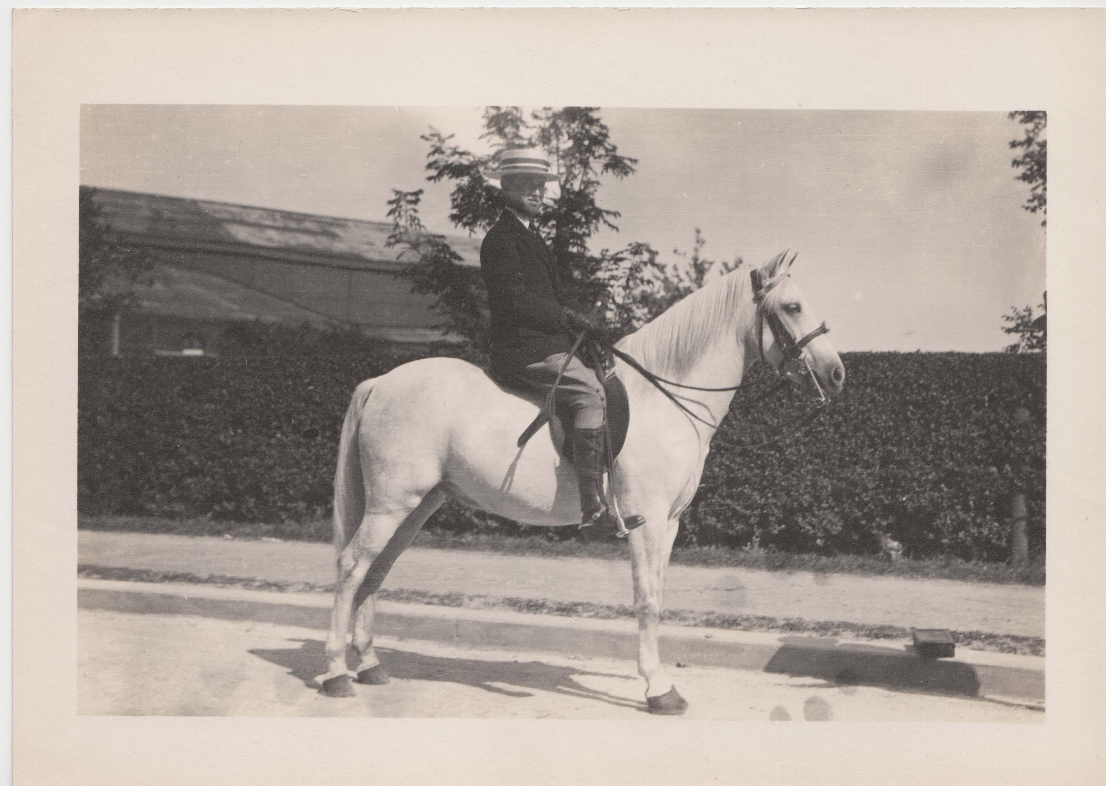 0198 Man on White Horse Close up