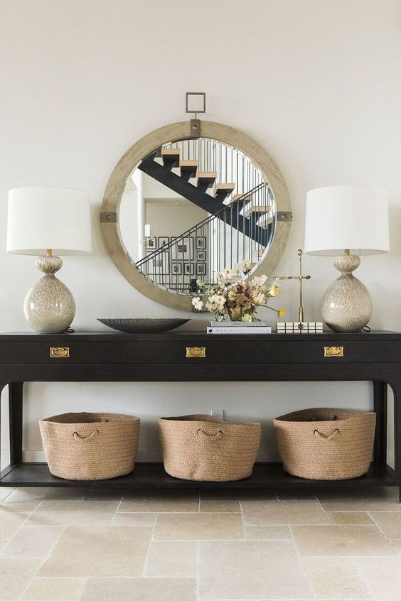 contemporary-entryway-with-round-mirror-and-baskets-for-storage-in-entryway-organization
