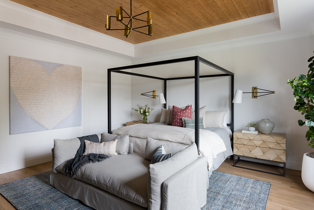 bedroom with black bed and Kerry Rosenthal painting