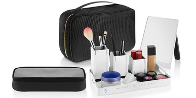 Genius cosmetic organizer. The unique TRAVELER comes with 3 pop-up/fold flat containers, portable mirror, take anywhere tray.