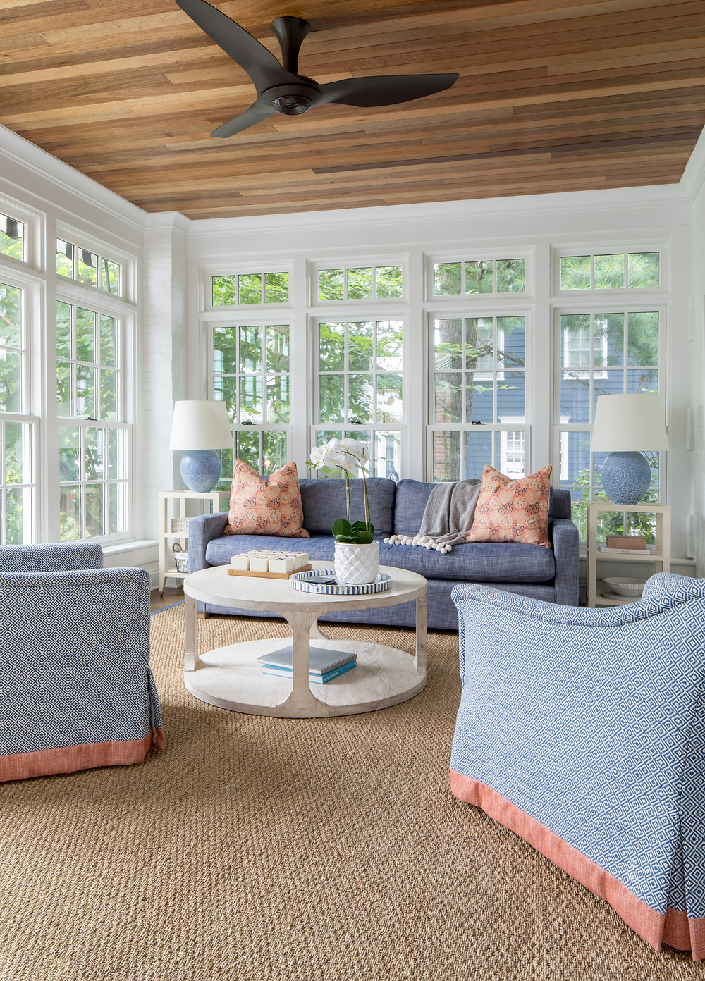 sunroom with blue and coral furnishings