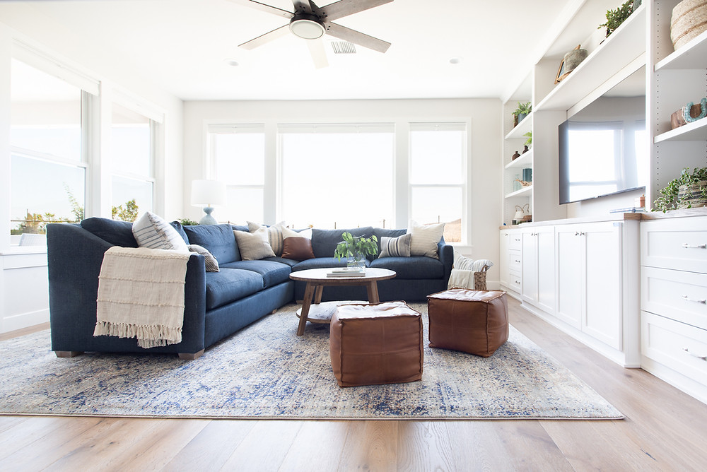 blue sectional in coastal living room