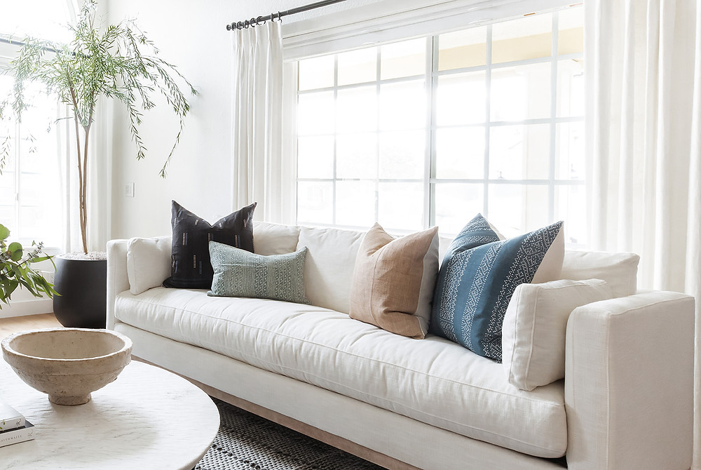linen sofa and olive tree