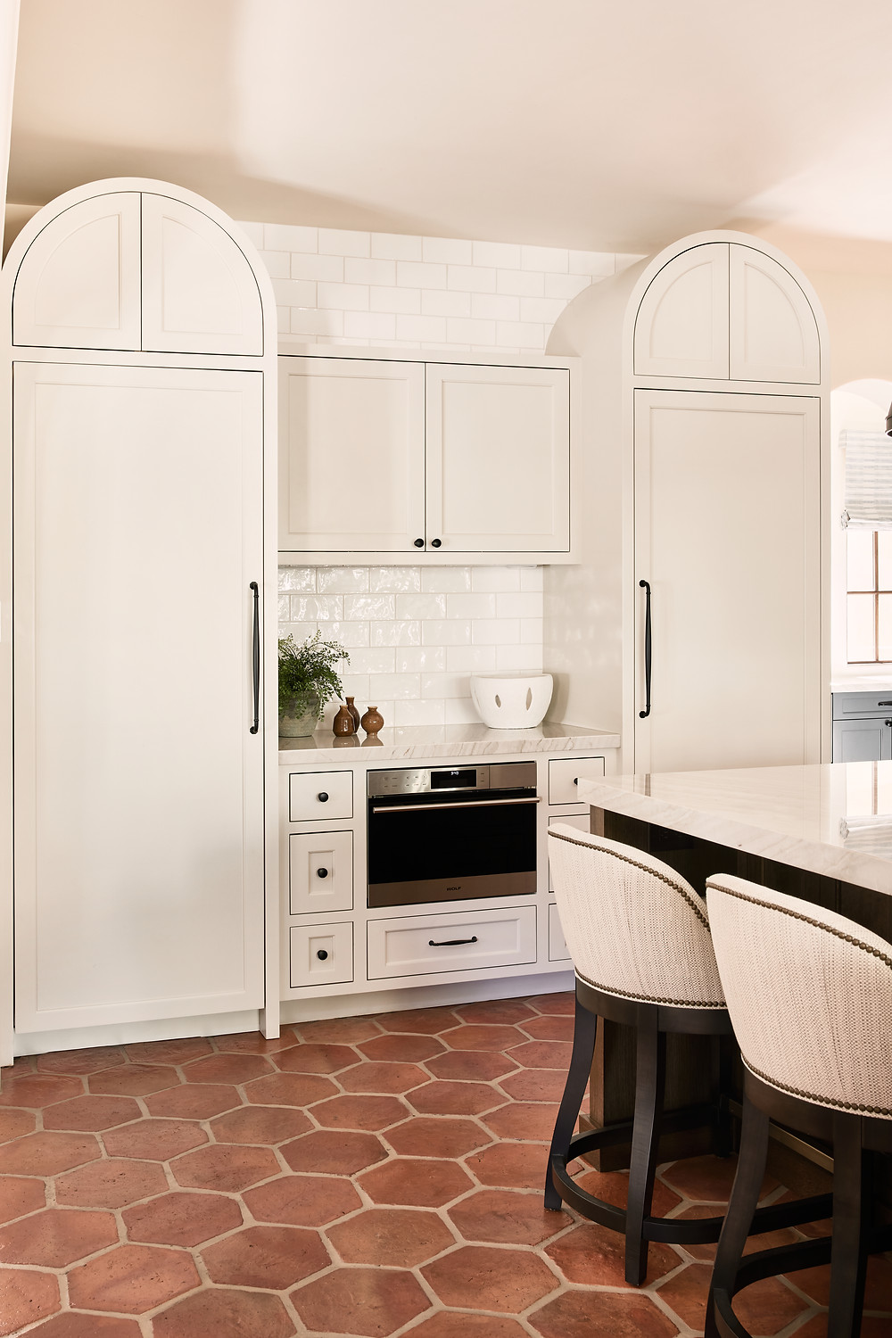 Spanish-style kitchen with terra cotta tile